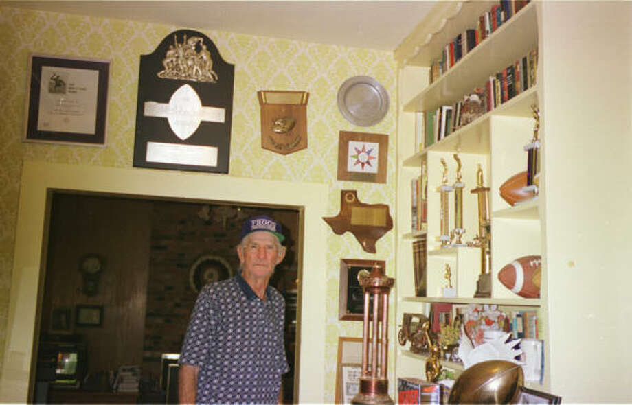At right, the humble Sammy Baugh reluctantly showed John McClain his numerous awards at his home in Rotan in July of 1998. Photo: John McClain, Houston Chronicle