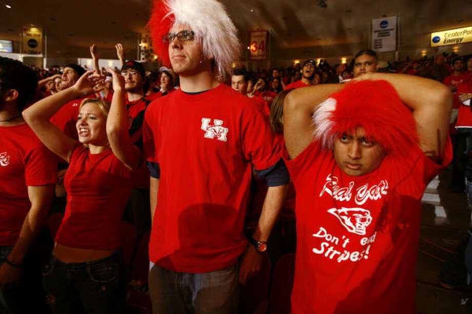UH fans in a packed Hofheinz Pavilion react as the Tigers pull away in the first half. Photo: Nick De La Torre, Chronicle