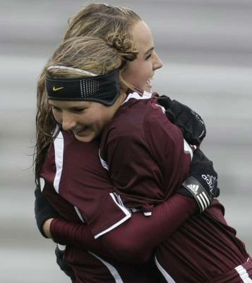 Cinco Ranch's Jaimie Leake, left, hugs teammate Missy Wentz after Wentz's goal in the 15th minute gave the Cougars the early lead en route to a 3-1 victory over Clear Brook at District Stadium. Photo: KAREN WARREN, CHRONICLE