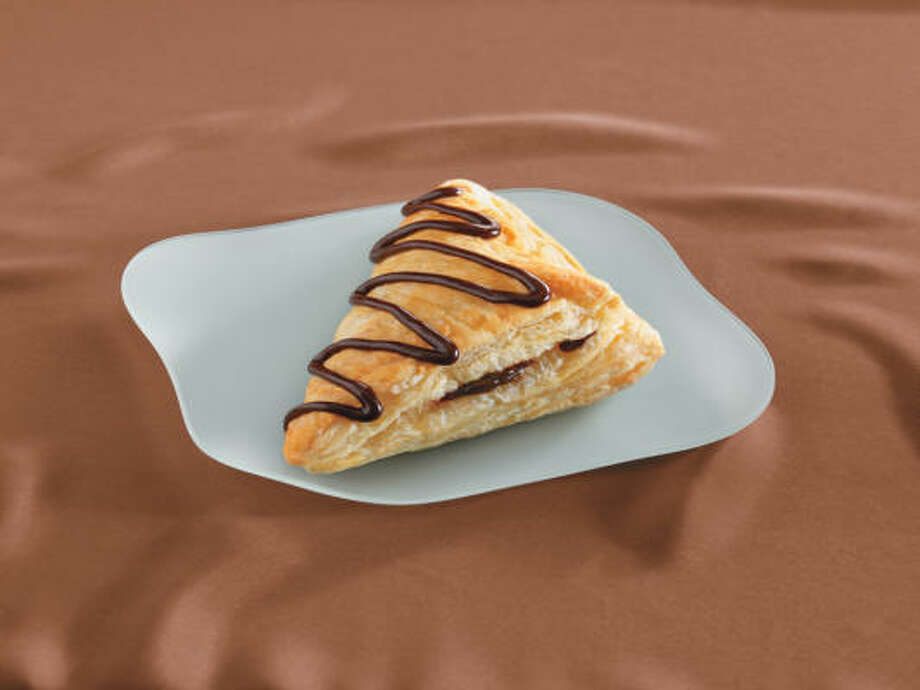 Arby's Chocolate Turnover features gooy chocolate covered with a flaky pastry topped with chocolate drizzle.