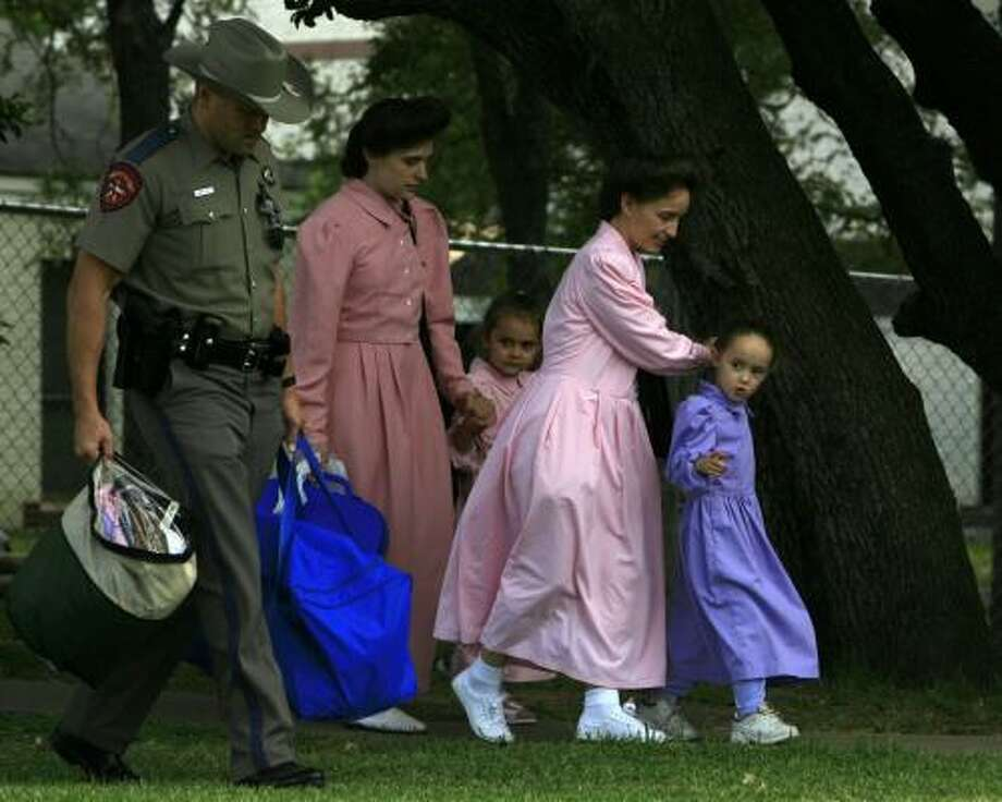 Two female members of the FLDS church pick up two young children from KidzHarbor group home Tuesday in Liverpool. A judge approved the release of nearly 450 children from foster care, ending a two-month battle between the polygamist sect and the state. Photo: ERIC KAYNE, CHRONICLE