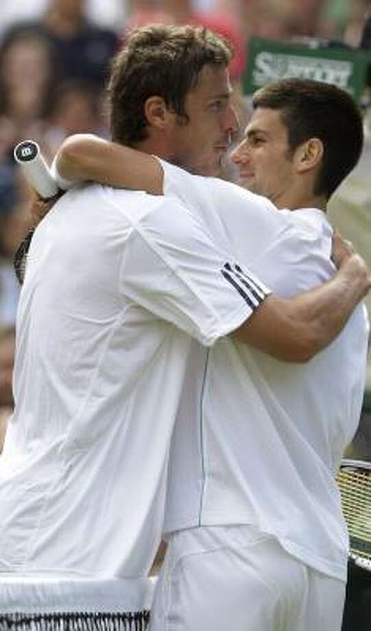 Marat Safin, left, moved on to the third round at the expense of third-seeded Novak Djokovic. Photo: ANJA NIEDRINGHAUS, AP