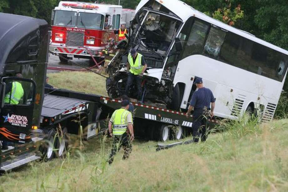 A chartered bus from Houston is loaded onto a wrecker Friday in Sherman after a fatal accident involving church members. Photo: Chris Jennings, AP