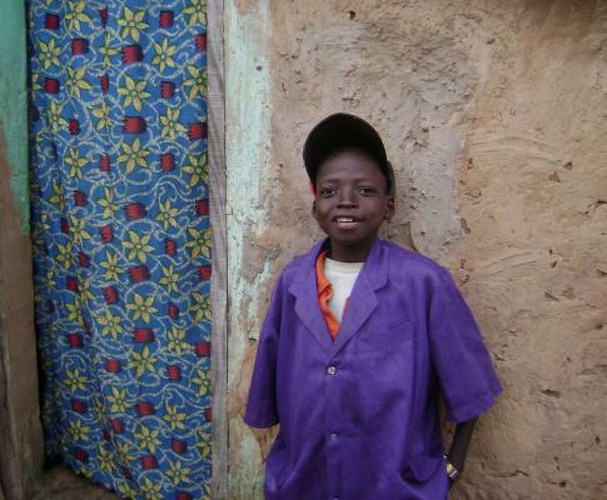 Jean Sawadogo looks about 9, but he is actually 18. His growth was stunted by HIV. The Baylor College of Medicine's International Pediatric AIDS Initiative is helping the teen.