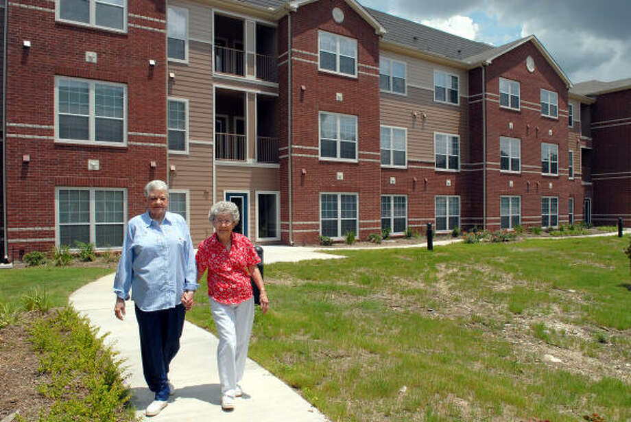 Helen Barton, left, and Dorothy Johnson take a stroll in the courtyard area of their new home. The Birdsong Place Villas is a 96-unit senior citizen apartment complex for people with low to moderate income. Photo: Kim Christensen, For The Chronicle