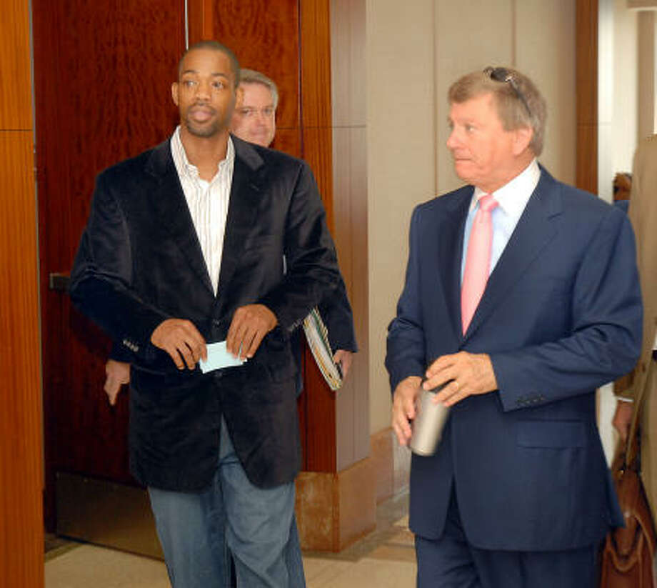 Houston Rockets guard Rafer Alston, shown leaving court last month with his attorney, Rusty Hardin, right, is set for trial in October on a drunken-driving charge. Photo: Dave Rossman, For The Chronicle