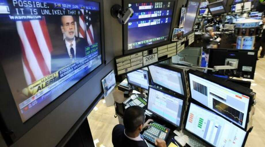 Federal Reserve Chairman Ben Bernanke appears Tuesday on a TV screen on the floor of the New York Stock Exchange. Photo: RICHARD DREW, ASSOCIATED PRESS