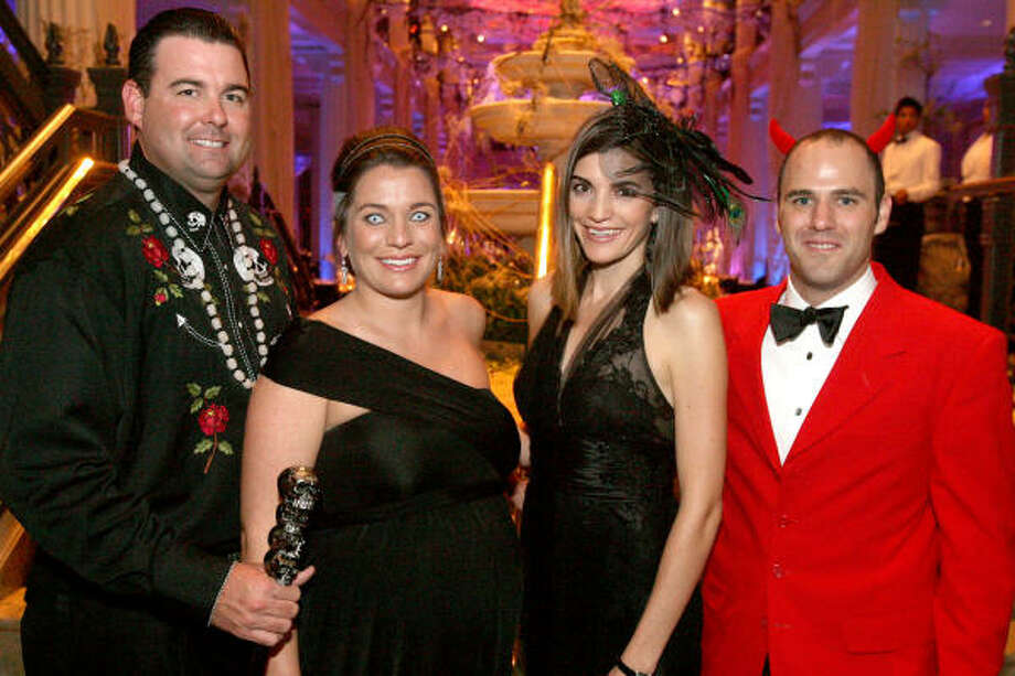 """Parker and Victoria Johnson, she with the temporary zombie eyes, joined Liz and Andy Stepanian, right, as chairs of the Children's Museum of Houston """"Thriller of a Night"""" gala held at the Corinthian. Photo: Bill Olive, For The Chronicle"""