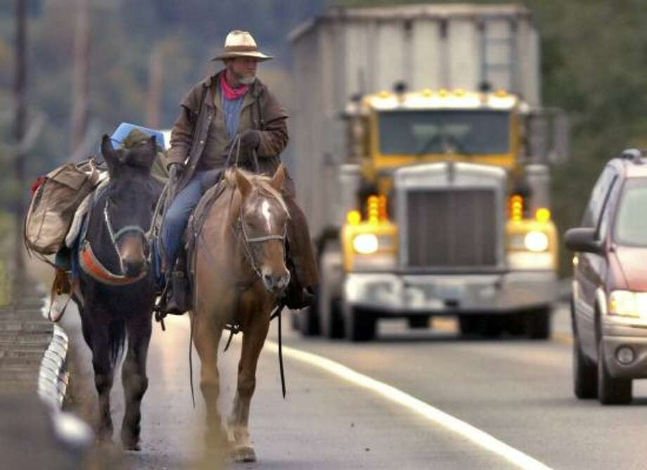 "For Mark Ryan, riding across the West on his horse — Mister Doodles — to visit friends was a chance to see the country in a way not many other people do. ""There's nothing like traveling 2 miles an hour,"" said Ryan. Photo: FRANK VARGA, SKAGIT VALLEY HERALD"
