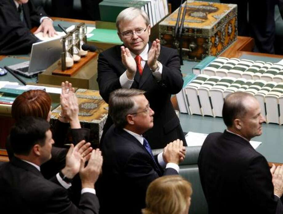 "Australian Prime Minister Kevin Rudd, top, applauds a group of Aborigines from the ""Stolen Generations"" who were in the public gallery of Parliament today. Photo: MARK BAKER, AP"
