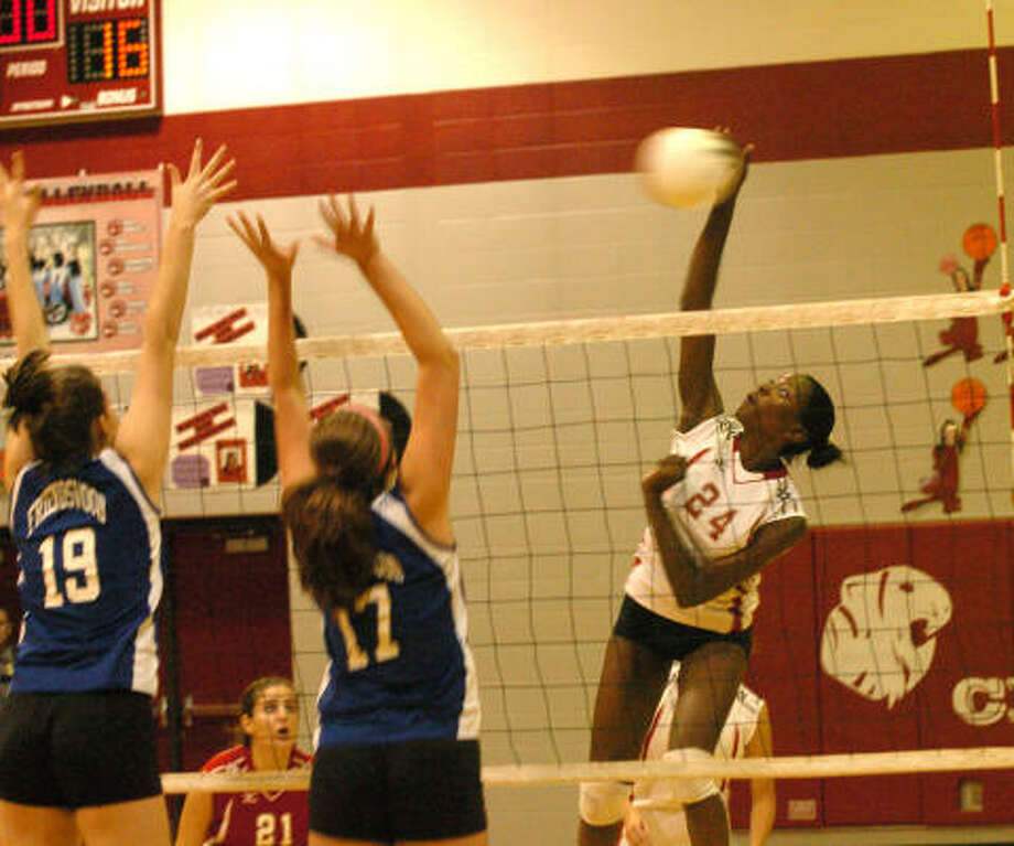 EDDIE MATCHETTE: FOR THE CHRONICLE Ashley Bannister led the way for Travis to go 3-0 in pool play and advance to the second round of the championship bracket in the Nike Volleyball Classic recently in Pearland. Photo: Eddy Matchette