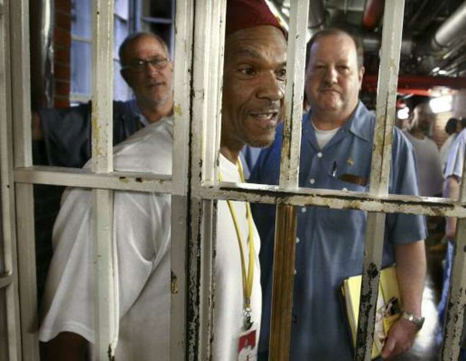 Vietnam veterans Frederic D. Jones, front, and John E. Barba, center, wait with other inmates at the Maryland Correctional Institution near Hagerstown to attend a veterans meeting. The two are co-chairmen of the prison's veterans history committee. Photo: JASON TURNER, ASSOCIATED PRESS