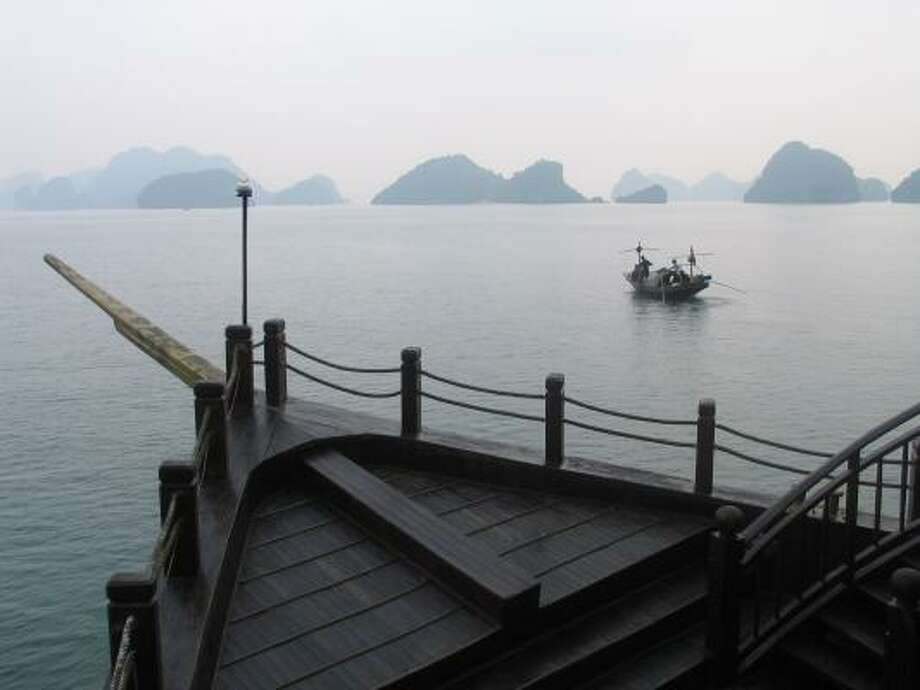 TRANQUIL: The prow of the Halong Jasmine cuts through the quiet water of Halong Bay. Photo: Ellen Creager