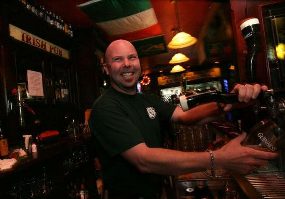 Bartender Kevin Patterson pours a Guinness stout at Brian O'Neill's Traditional Irish Pub, 5555 Morningside. Photo: BILLY SMITH II, CHRONICLE