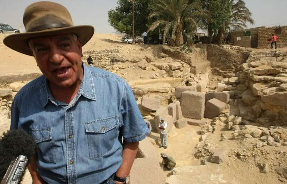 """Zahl Hawass, Egypt's antiquities chief, speaks near the remains of the """"Headless Pyramid."""" Photo: CRIS BOURONCLE, AFP/GETTY IMAGES"""