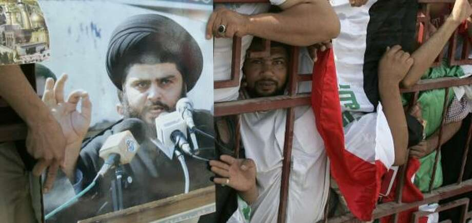 Demonstrators press against a railing Saturday in support of Shiite cleric Muqtada al-Sadr in Baghdad. Photo: KARIM KADIM, ASSOCIATED PRESS