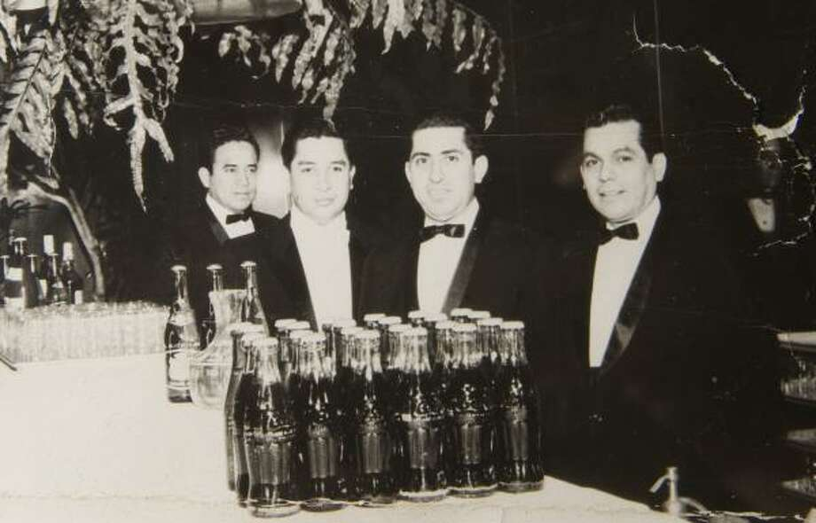 Rudy Castro, second from left, and his staff at the Rice Hotel 45 years ago. Photo: CASTRO FAMILY PHOTO, Family Photo