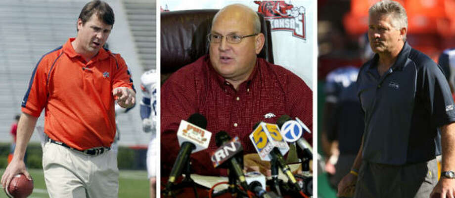 Will Muschamp (left) replaces Larry Mac Duff at Texas, who stepped down on Wednesday. Reggie Herring (center) comes to Texas A&M after serving as the defensive coordinator and linebackers coach at Arkansas, and Nolan Cromwell, the receivers coach in Seattle, will be introduced as the new offensive coordinator at A&M once the Seahawks are finished in the playoffs. Photo: Seattle Seahawks/AP/AP