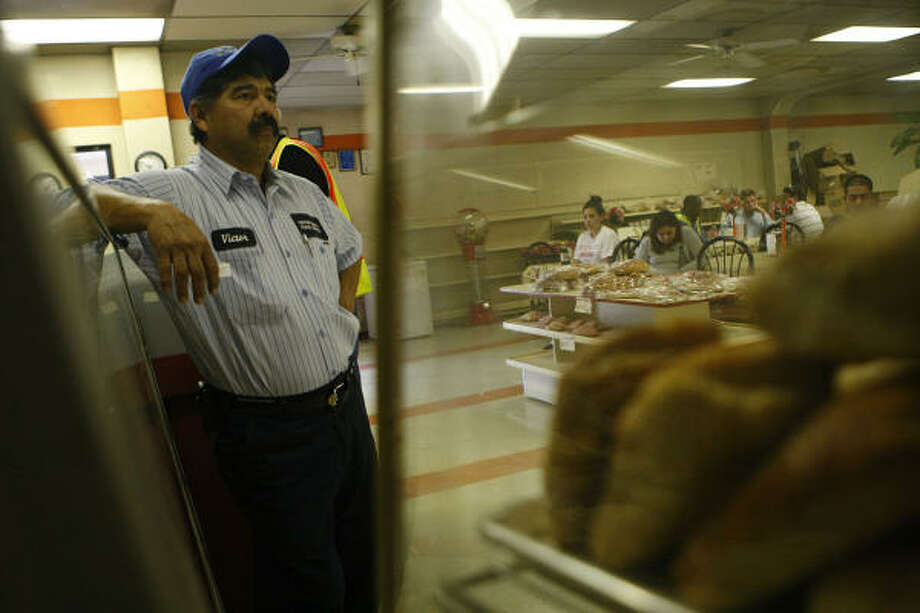 Victor Garcia, Sr., waits for his breakfast taco order at Porras Prontito Cafe. Photo: Mayra Beltran, Houston Chronicle