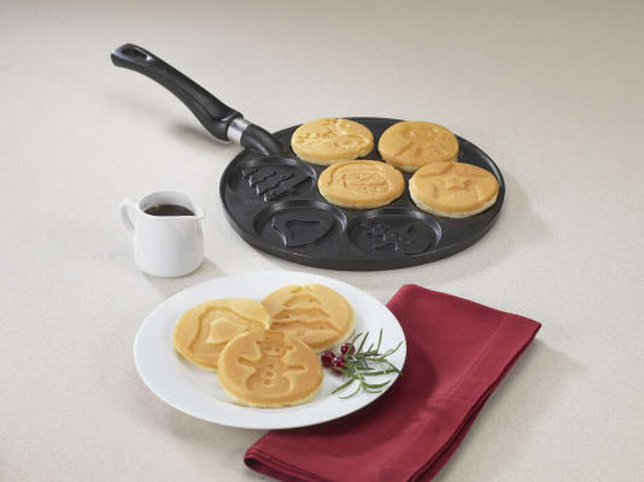 The Nordic Ware Holiday Pancake Pan makes seven dollar-size pancakes or blinis with holiday designs. Photo: NORDIC WARE PHOTOS