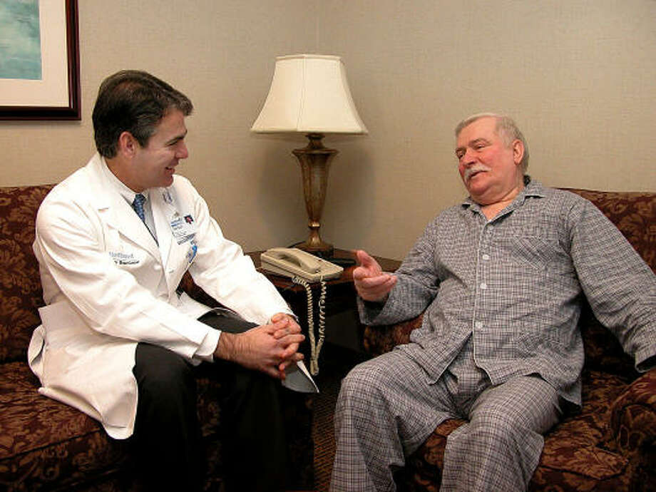 "Former Polish President Lech Walesa, shown with his  cardiologist, Dr. Guillermo Torre, in Houston last week, proclaimed in a statement, ""Dictators and oppressors should continue to fear me because I will be here for a long time."" Photo: DENNY ANGELLE, Methodist Hospital's DeBakey Heart And Vascular Center"