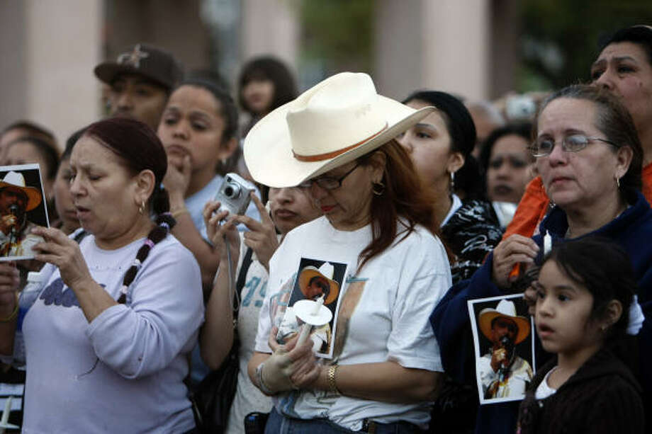 The family of Emilio Navaira is thanking his fans, such as these who gathered for a recent prayer vigil and concert to show support for the Tejano singer. He remains in critical condition at Memorial Hermann Hospital with injuries from the March 23 crash of his tour bus. Photo: Johnny Hanson, Houston Chronicle