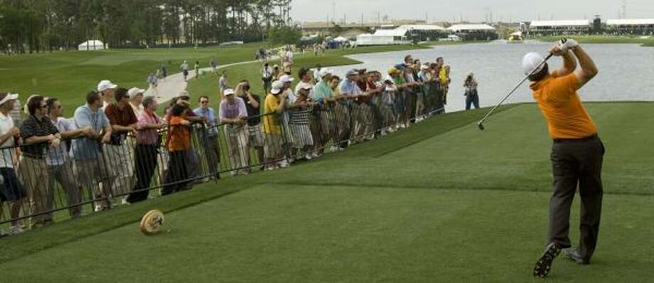 Fans gather to watch Phil Mickelson tee off on the 18th hole during Thursday's first round of the Shell Houston Open. Photo: BRETT COOMER, CHRONICLE