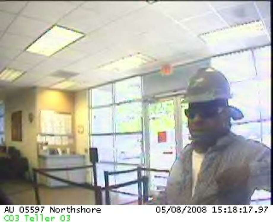 Crime Stoppers is offering up to $5,000 for information in the search for a hard-hatted robber who held up an east Harris County bank. Photo: Federal Bureau Of Investigation