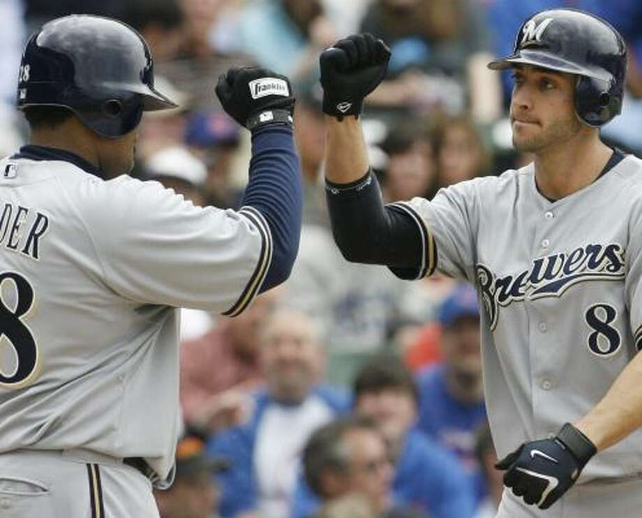 Milwaukee's Ryan Braun is congratulated by Prince Fielder after hitting a home run in the sixth inning. Braun's two-run double in the ninth sparked the Brewers to a 4-3 victory at Wrigley Field. Photo: NAM Y. HUH, ASSOCIATED PRESS