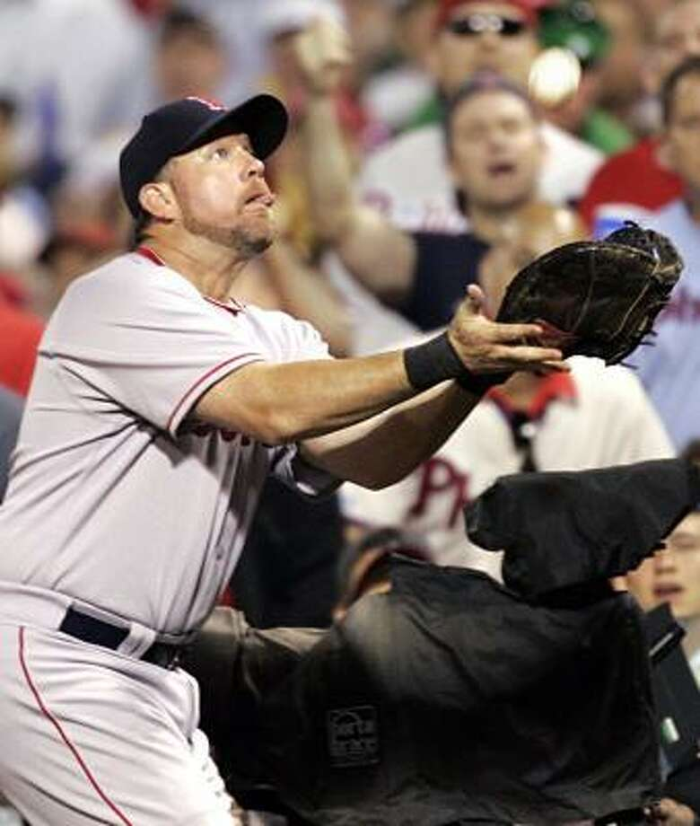 The Red Sox's Sean Casey shows he's not distracted by Phillies fans in catching a pop foul Tuesday. Photo: TOM MIHALEK, ASSOCIATED PRESS