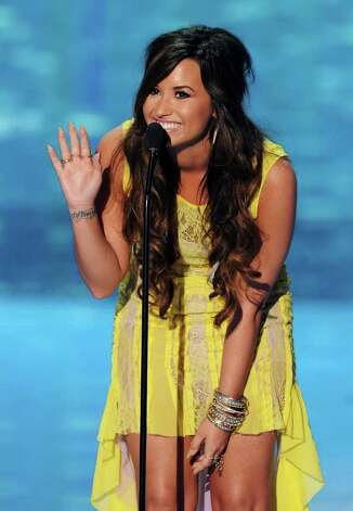 Actress/singer Demi Lovato speaks onstage during the 2011 Teen Choice Awards held at the Gibson Amphitheatre in Universal City, California. Photo: Kevin Winter, Getty Images / 2011 Getty Images