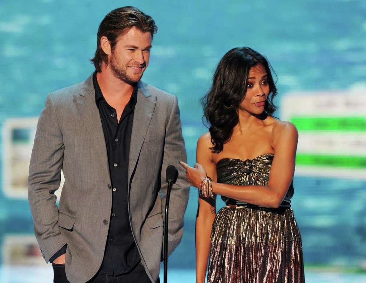 Actors Chris Hemsworth (L) and Zoe Saldana speak onstage during the 2011 Teen Choice Awards held at the Gibson Amphitheatre in Universal City, California.