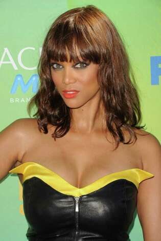 TV personality Tyra Banks arrives at the 2011 Teen Choice Awards held at the Gibson Amphitheatre in Universal City, California. Photo: Jason Merritt, Getty Images / 2011 Getty Images