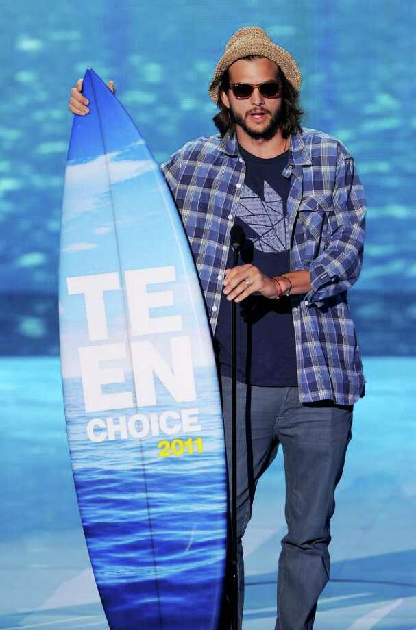 UNIVERSAL CITY, CA - AUGUST 07:  Actor Ashton Kutcher accepts the Choice Movie Actor: Romantic Comedy award onstage during the 2011 Teen Choice Awards held at the Gibson Amphitheatre on August 7, 2011 in Universal City, California. Photo: Kevin Winter, Getty Images / 2011 Getty Images