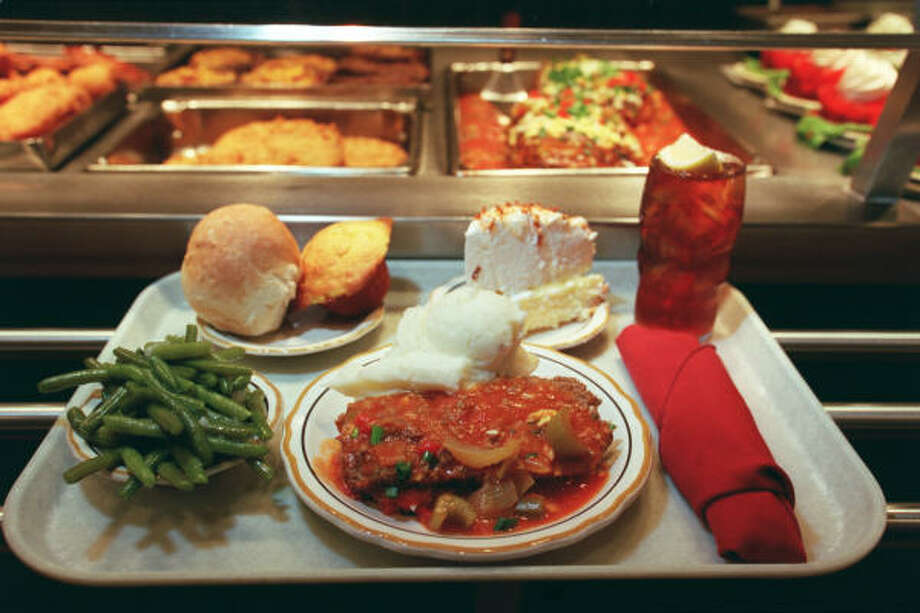 Meatloaf with red gravy and mashed potatoes, fresh green beans, dinner roll and cornbread, coconut meringue pie and ice tea at Cleburne Cafeteria. Photo: Buster Dean, Houston Chronicle