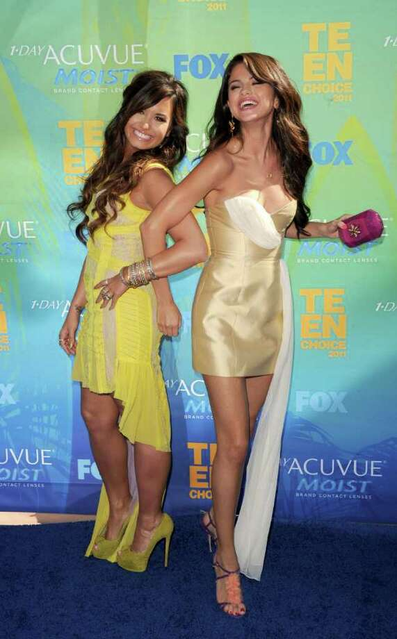 UNIVERSAL CITY, CA - AUGUST 07:  Actresses/singers Demi Lovato and Selena Gomez arrive at the 2011 Teen Choice Awards held at the Gibson Amphitheatre on August 7, 2011 in Universal City, California. Photo: Jason Merritt, Getty Images / 2011 Getty Images