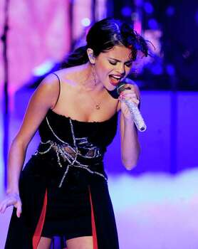 UNIVERSAL CITY, CA - AUGUST 07:  Singer Selena Gomez of Selena Gomez & The Scene perform onstage during the 2011 Teen Choice Awards held at the Gibson Amphitheatre on August 7, 2011 in Universal City, California. Photo: Kevin Winter, Getty Images / 2011 Getty Images