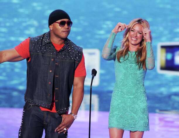 Actor/rapper LL Cool J (L) and TV personality Cat Deeley speak onstage during the 2011 Teen Choice Awards held at the Gibson Amphitheatre in Universal City, California. Photo: Kevin Winter, Getty Images / 2011 Getty Images