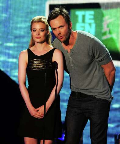 Actors Gillian Jacobs (L) and Joel McHale speak onstage during the 2011 Teen Choice Awards held at the Gibson Amphitheatre in Universal City, California. Photo: Kevin Winter, Getty Images / 2011 Getty Images