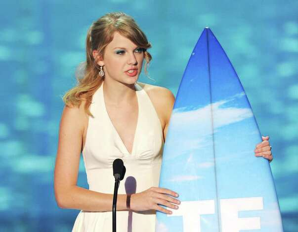 Musician Taylor Swift accepts the Choice Female Artist award onstage during the 2011 Teen Choice Awards held at the Gibson Amphitheatre in Universal City, California. Photo: Kevin Winter, Getty Images / 2011 Getty Images