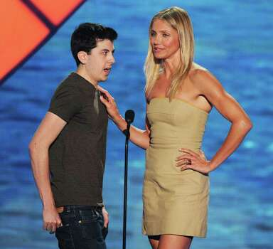 UNIVERSAL CITY, CA - AUGUST 07:  Actor Christopher Mintz-Plasse (L) and actress Cameron Diaz speak onstage during the 2011 Teen Choice Awards held at the Gibson Amphitheatre on August 7, 2011 in Universal City, California. Photo: Kevin Winter, Getty Images / 2011 Getty Images