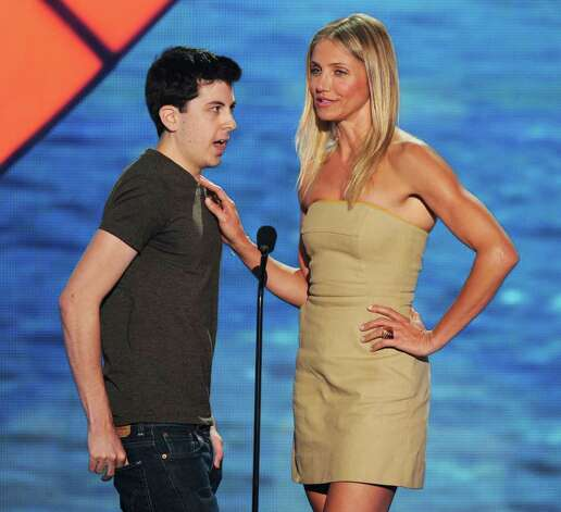 Actor Christopher Mintz-Plasse (L) and actress Cameron Diaz speak onstage during the 2011 Teen Choice Awards held at the Gibson Amphitheatre in Universal City, California. Photo: Kevin Winter, Getty Images / 2011 Getty Images