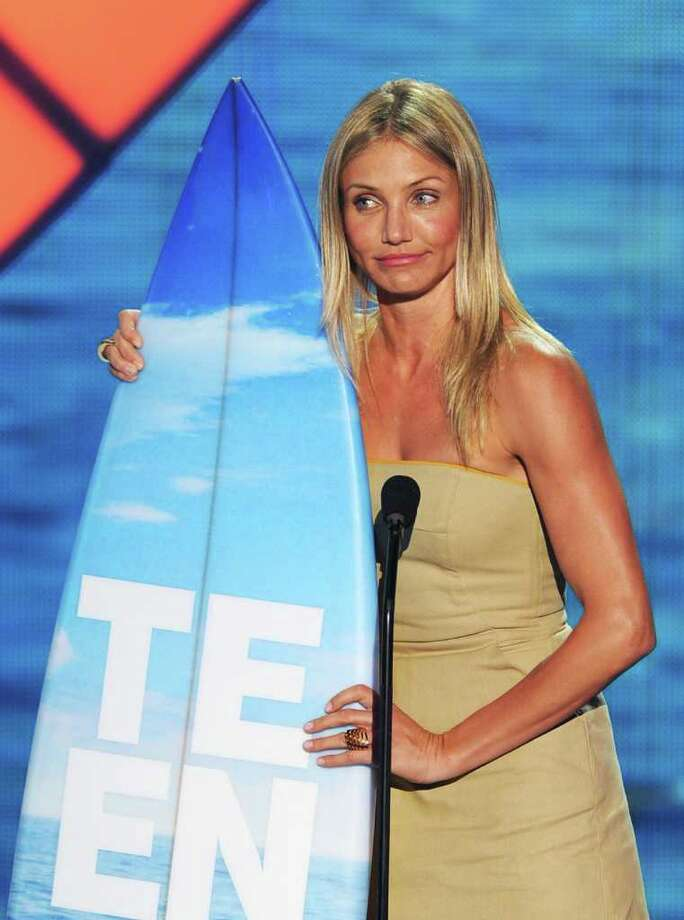 Actress Cameron Diaz accepts the Choice Comedy Movie Actress award onstage during the 2011 Teen Choice Awards held at the Gibson Amphitheatre in Universal City, California. Photo: Kevin Winter, Getty Images / 2011 Getty Images