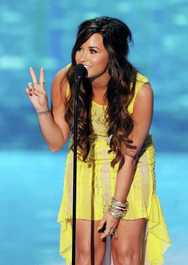 UNIVERSAL CITY, CA - AUGUST 07:  Actress/singer Demi Lovato speaks onstage during the 2011 Teen Choice Awards held at the Gibson Amphitheatre on August 7, 2011 in Universal City, California. Photo: Kevin Winter, Getty Images / 2011 Getty Images