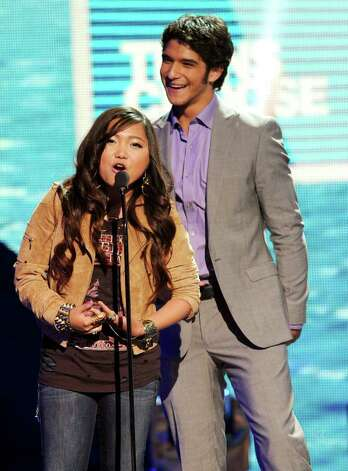 Singer Charice (L) and actor Tyler Posey speak onstage during the 2011 Teen Choice Awards held at the Gibson Amphitheatre in Universal City, California. Photo: Kevin Winter, Getty Images / 2011 Getty Images