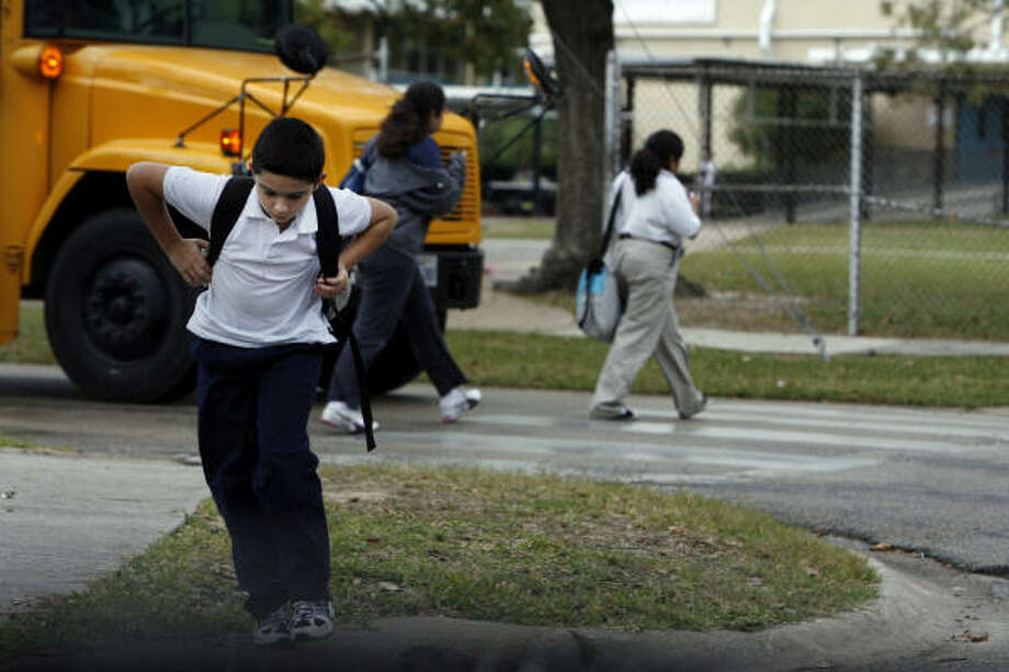 Tristen Kent, 12, rides the bus to and from Clifton Middle School, where he is a magnet student. His mother, Kelly Spivey, says she wants HISD to find other ways to save money. Photo: Eric Kayne, Chronicle