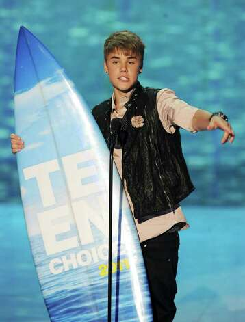 UNIVERSAL CITY, CA - AUGUST 07:  Singer Justin Bieber accepts the Choice Male Artist award onstage during the 2011 Teen Choice Awards held at the Gibson Amphitheatre on August 7, 2011 in Universal City, California. Photo: Kevin Winter, Getty Images / 2011 Getty Images