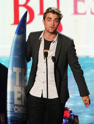 Actor Robert Pattinson accepts the Choice Vampire award onstage during the 2011 Teen Choice Awards held at the Gibson Amphitheatre in Universal City, California. Photo: Kevin Winter, Getty Images / 2011 Getty Images