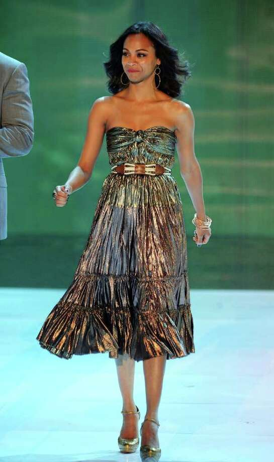 UNIVERSAL CITY, CA - AUGUST 07:  Actress Zoe Saldana walks onstage during the 2011 Teen Choice Awards held at the Gibson Amphitheatre on August 7, 2011 in Universal City, California. Photo: Kevin Winter, Getty Images / 2011 Getty Images