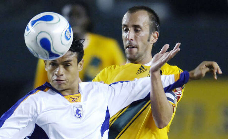 Playing teams such as Saprissa only can help the MLS draw more fans, Glenn Davis argues. Photo: CHRIS PIZZELLO, AP